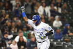 Kansas City Royals' Salvador Perez points skyward as he heads home on his grand slam against the Seattle Mariners in the fourth inning of a baseball game Friday, Aug. 27, 2021, in Seattle. (AP Photo/Elaine Thompson)