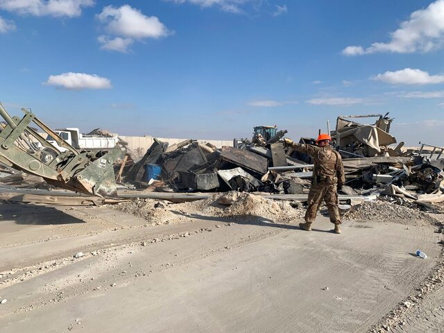 U.S. soldiers clear rubble from a site of Iranian bombing at Ain al-Asad air base in Anbar, Iraq, Monday, Jan. 13, 2020. Ain al-Asad air base was struck by a barrage of Iranian missiles, in retaliation for the U.S. drone strike that killed atop Iranian commander, Gen. Qassem Soleimani, whose killing raised fears of a wider war in the Middle East. (AP Photo/Ali Abdul Hassan)