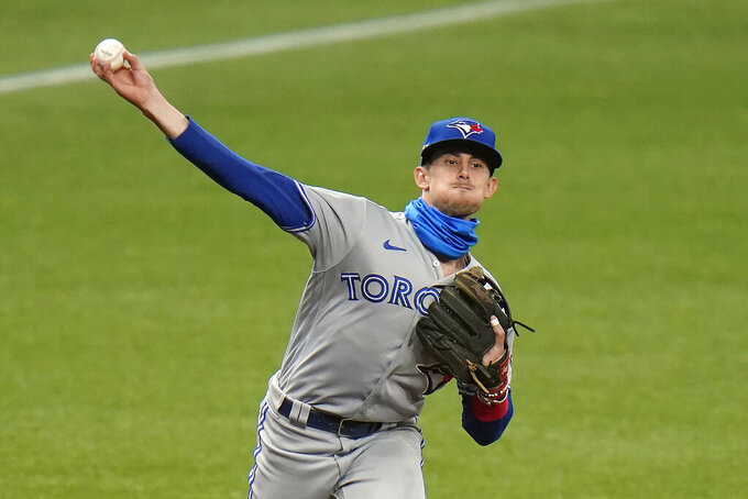 Toronto Blue Jays third baseman Cavan Biggio throws out Tampa Bay Rays' Mike Zunino at first during the fifth inning of Game 1 of a wild card series playoff baseball game Tuesday, Sept. 29, 2020, in St. Petersburg, Fla. (AP Photo/Chris O'Meara)