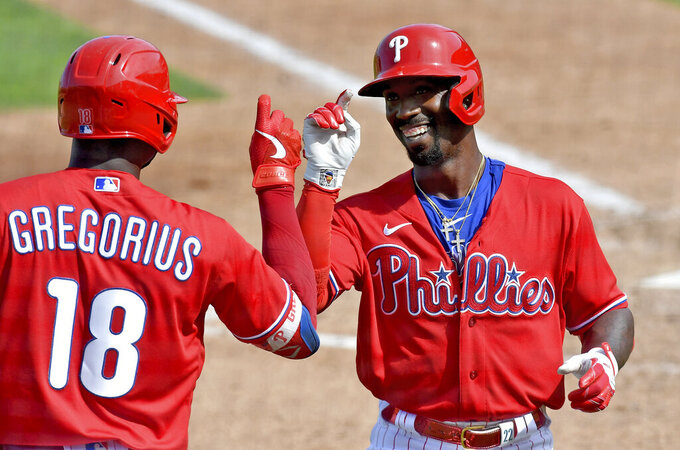 Philadelphia Phillies' Didi Gregorius congratulates Andrew McCutchen after he a home run off Pittsburgh Pirates pitcher Blake Cederlind  during a spring training baseball game, Friday, March 5, 2021, at Baycare Ballpark in Clearwater, Fla. (Matt Freed/Pittsburgh Post-Gazette via AP)