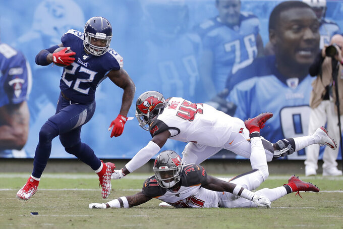 Tennessee Titans running back Derrick Henry (22) runs past Tampa Bay Buccaneers defenders Devin White (45) and Jordan Whitehead (31) in the second half of an NFL football game Sunday, Oct. 27, 2019, in Nashville, Tenn. (AP Photo/James Kenney)