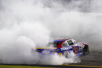 Martin Truex Jr. (19) does a burnout as he celebrates winning the NASCAR Cup series auto race in Richmond, Va., Saturday, Sept. 11, 2021. (AP Photo/Steve Helber)