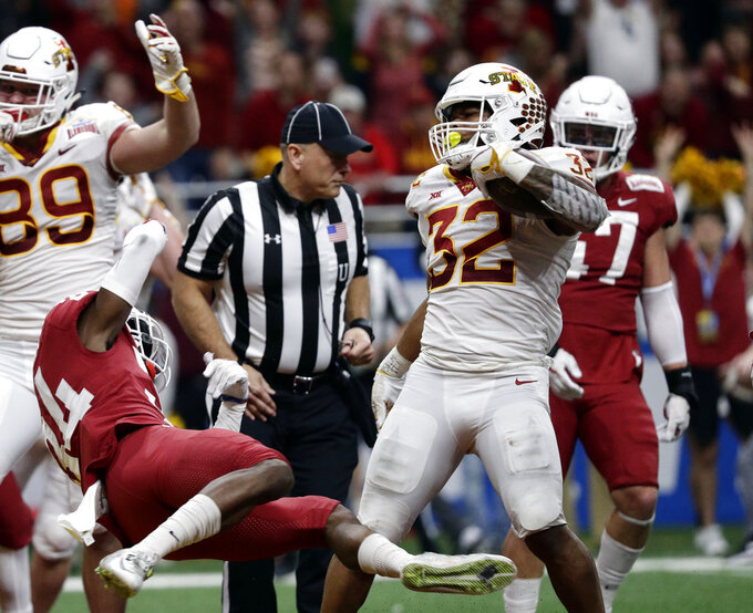 Iowa State running back David Montgomery (32) runs for a touchdown against Washington State during the second half of the Alamo Bowl NCAA college football game Friday, Dec. 28, 2018, in San Antonio. (AP Photo/Eric Gay)