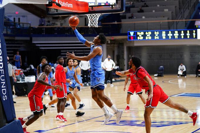 Villanova's Jermaine Samuels goes up for a shot during the first half of an NCAA college basketball game against St. John's, Tuesday, Feb. 23, 2021, in Villanova, Pa. (AP Photo/Matt Slocum)