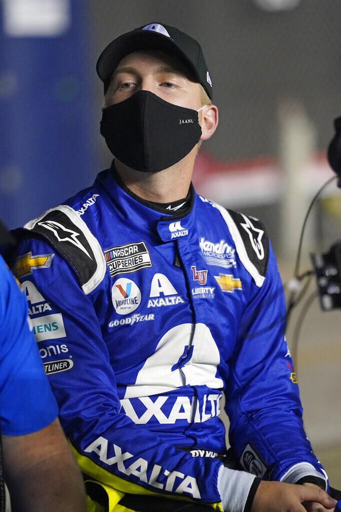 William Byron watches cars on the speedway during NASCAR Daytona 500 auto race qualifying at Daytona International Speedway, Wednesday, Feb. 10, 2021, in Daytona Beach, Fla. (AP Photo/John Raoux)