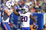 Buffalo Bills' Frank Gore (20) celebrates his touchdown during the second half of an NFL football game against the New York Giants, Sunday, Sept. 15, 2019, in East Rutherford, N.J. (AP Photo/Adam Hunger)