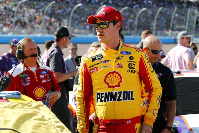 FILE - In this Nov. 10, 2019, file photo, Joey Logano is shown prior to the NASCAR Cup Series auto race at ISM Raceway in Avondale, Ariz. Logano was sitting in his motorhome watching television when a shell-shocked Erik Jones was interviewed about his firing from Joe Gibbs Racing.  Logano knew exactly how Jones felt. Logano had been in that exact spot eight years earlier. (AP Photo/Ralph Freso, File)