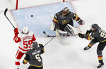 Detroit Red Wings left wing Tyler Bertuzzi (59) tries to knock the puck out of the air near Vegas Golden Knights defenseman Deryk Engelland (5), goaltender Malcolm Subban (30) and left wing Tomas Nosek (92) during the second period of an NHL hockey game Saturday, March 23, 2019, in Las Vegas. (AP Photo/John Locher)