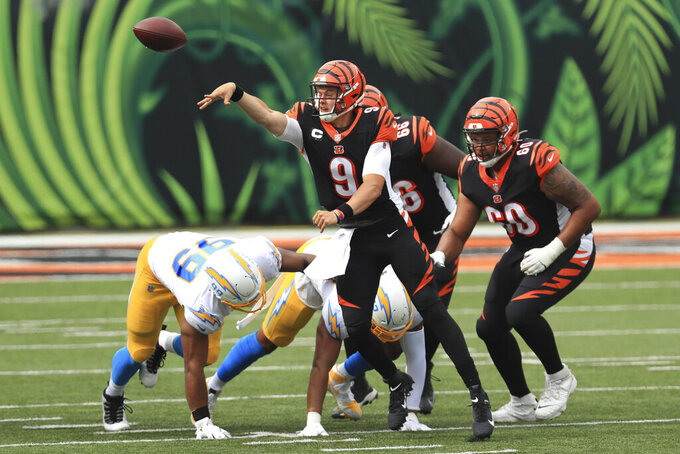Cincinnati Bengals quarterback Joe Burrow (9) throws during the first half of an NFL football game against the Los Angeles Chargers, Sunday, Sept. 13, 2020, in Cincinnati. (AP Photo/Aaron Doster)