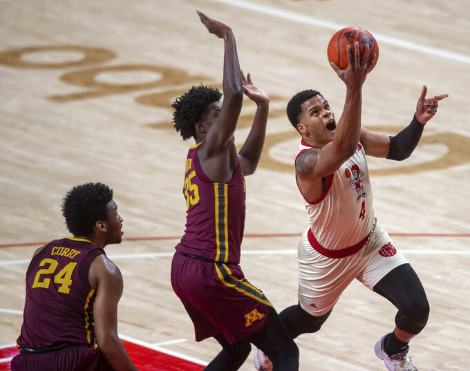 Nebraska guard Shamiel Stevenson (4) drives to the basket against Minnesota's Isaiah Ihnen (35) and Eric Curry (24) during the second half of an NCAA college basketball game Saturday, Feb. 27, 2021, in Lincoln, Neb. (Francis Gardler/Lincoln Journal Star via AP)