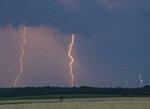 Lightning strikes over a field near wind turbines in Treplin, Germany, June 12, 2019. (Patrick Pleul/dpa via AP)