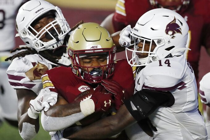 FILE - In this Sept. 26, 2020, file photo, Texas State linebacker Christian Taylor, left, and safety Tory Spears (14) tackle Boston College running back David Bailey during the first half of an NCAA college football game, in Boston.  Texas State plkays ast BYU on Saturday, Oct. 24.(AP Photo/Michael Dwyer, File)