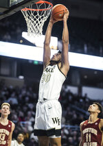 Wake Forest center Olivier Sarr (30) dunks in the first half of an ACC college basketball game against Boston College on Sunday, Jan. 19, 2020, at Joel Coliseum in Winston-Salem, N.C. (Allison Lee Isley/Winston-Salem Journal via AP)