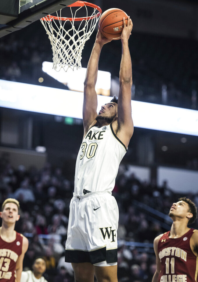 Wake Forest center Olivier Sarr (30) dunks in the first half of an ACC college basketball game against Boston College on Sunday, Jan. 19, 2020, at Joel Coliseum in Winston-Salem, N.C. (Allison Lee Isley/Winston-Salem Journal via AP)