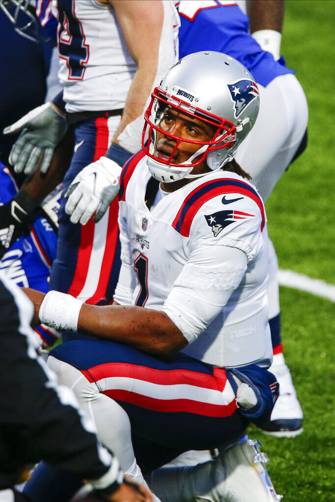 New England Patriots quarterback Cam Newton (1) reacts after fumbling the ball during the final drive of the second half of an NFL football game against the Buffalo Bills Sunday, Nov. 1, 2020, in Orchard Park, N.Y. The ball was recovered by Dean Marlowe as the Bills won 24-21. (AP Photo/John Munson)