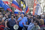 Vojislav Seselj, center, the leader of the ultranationalist Serbian Radical Party, speaks to his supporters over a megaphone during a protest in Belgrade, Serbia, Sunday, March 24, 2019. Members of the ultranationalist Serbian Radical Party gathered for a protest on Sunday in the Serbian capital to mark the 20th anniversary of the NATO led bombing campaign against Serbia in 1999. (AP Photo/Marko Drobnjakovic)