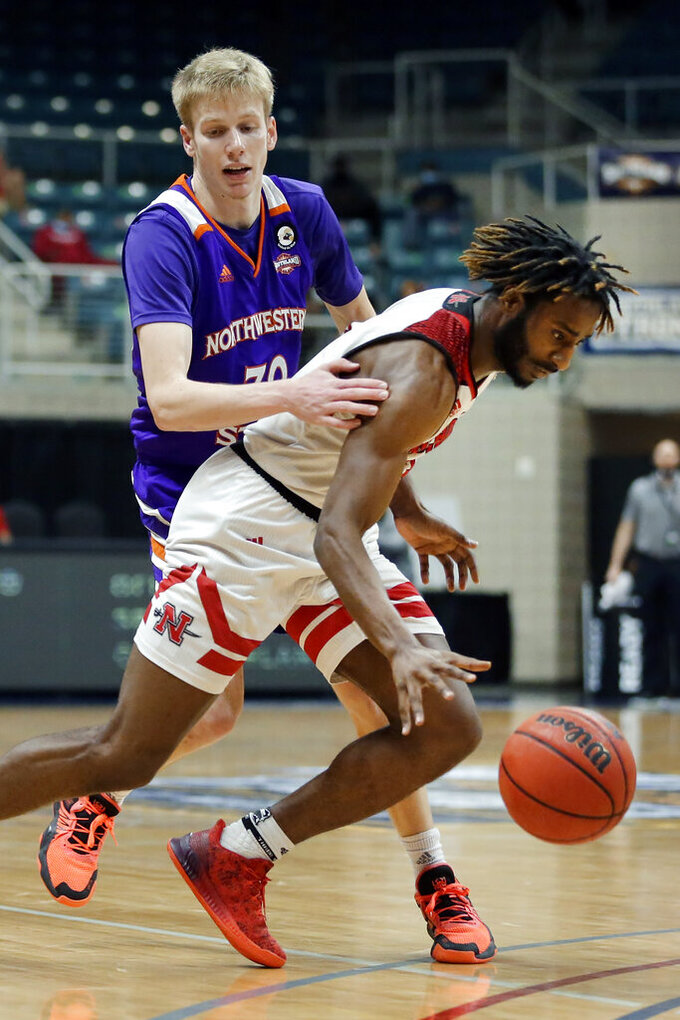 Northwestern State guard Trenton Massner, left, reaches around and fouls Nicholls State guard Andre Jones, right, during the second half of an NCAA college basketball game in the Southland Conference semifinals Friday, March 12, 2021, in Katy, Texas. (AP Photo/Michael Wyke)