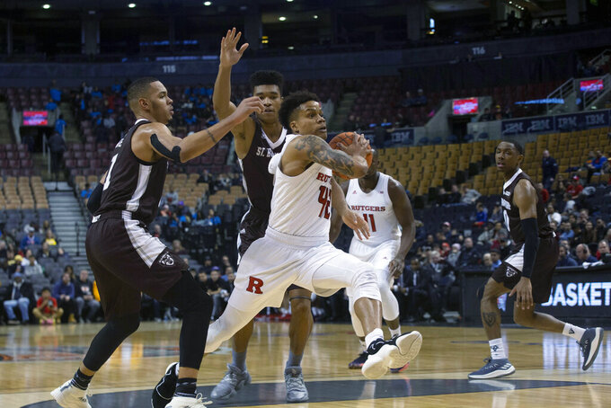 Rutgers' Jacob Young drives through the St. Bonaventure defense during the first half of an NCAA college basketball game in the James Naismith Classic, in Toronto on Saturday, Nov. 16, 2019. (Chris Young/The Canadian Press via AP)
