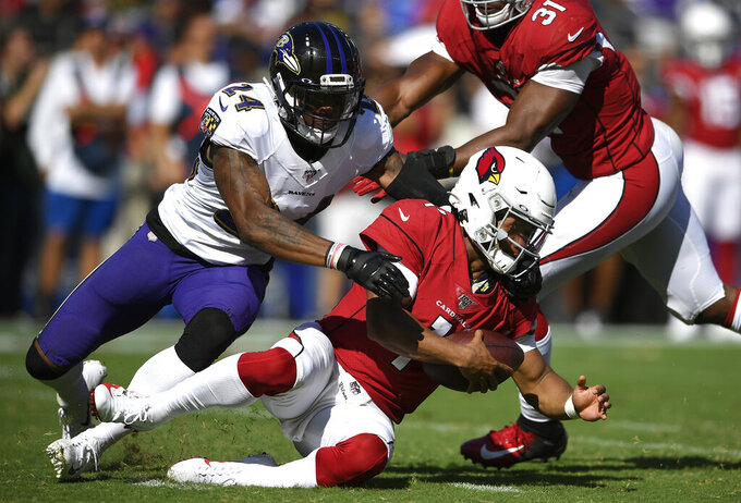 Baltimore Ravens cornerback Brandon Carr, left, sacks Arizona Cardinals quarterback Kyler Murray in the second half of an NFL football game, Sunday, Sept. 15, 2019, in Baltimore. (AP Photo/Nick Wass)