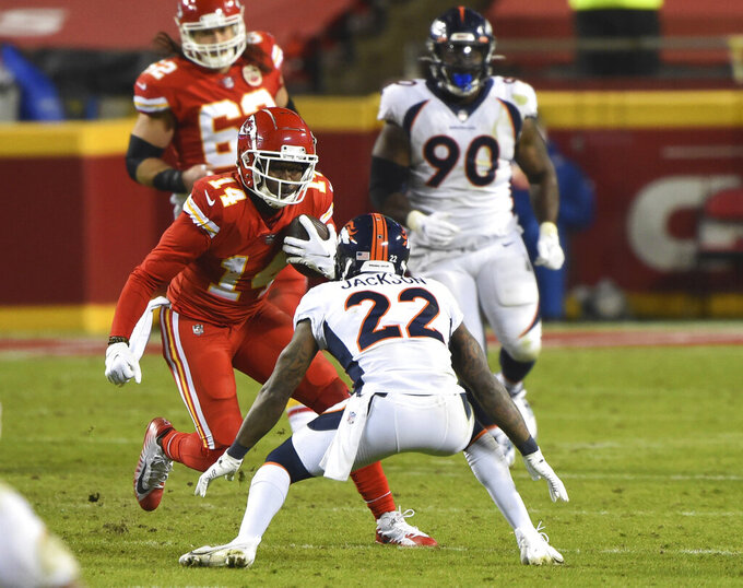 Kansas City Chiefs wide receiver Sammy Watkins (14) runs after catching a pass as Denver Broncos strong safety Kareem Jackson (22) defends in the second half of an NFL football game, Sunday, Dec. 6, 2020, in Kansas City, Mo. The Chiefs defeated the Broncos, 22-16. (Tammy Ljungblad/The Kansas City Star via AP)