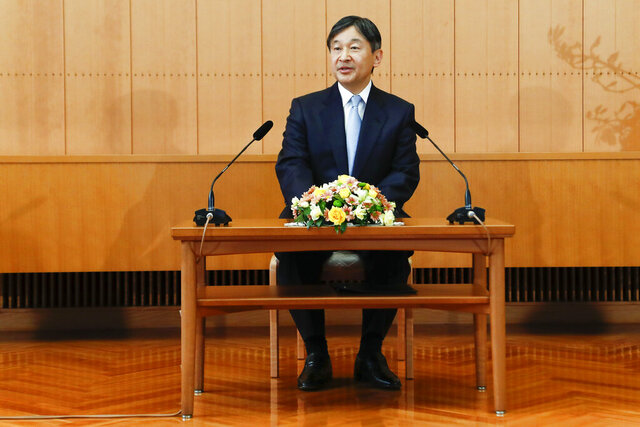 In this Friday, Feb. 21, 2020, photo,  Japan's Emperor Naruhito speaks during a news conference in Tokyo, ahead of his 60th birthday on Sunday, Feb. 23, 2020. Naruhito offered his sympathy to those affected by the new virus that emerged in China and said he hopes to see the outbreak contained soon. Birthday celebration plans had called for him to wave from the palace balcony to tens of thousands of well-wishers, but they were canceled as a precautionary anti-infection measure. (Rodrigo Reyes Marin/Pool Photo via AP)