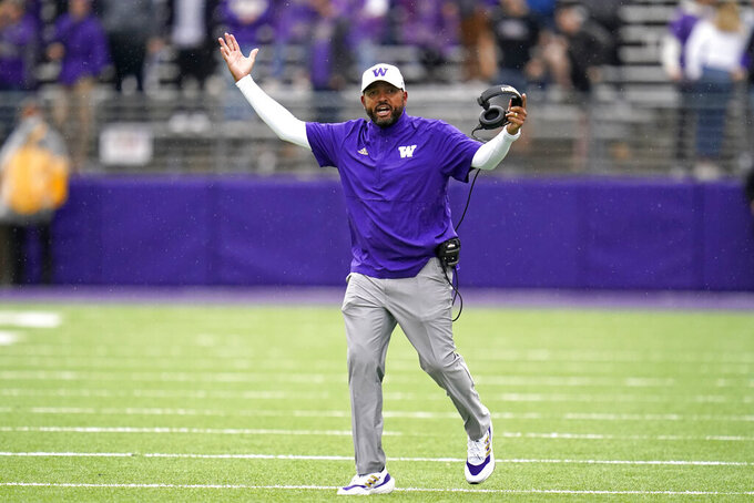 Washington head coach Jimmy Lake walks on the field as he reacts to a call in favor of Arkansas State in the second half of an NCAA college football game, Saturday, Sept. 18, 2021, in Seattle. (AP Photo/Elaine Thompson)