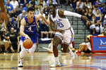 UCLA guard Prince Ali (23) chases down BYU guard Alex Barcello (4) during the first half of an NCAA college basketball game, Monday, Nov. 25, 2019, in Lahaina, Hawaii. (AP Photo/Marco Garcia)