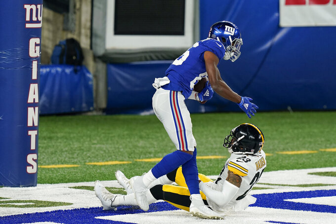 New York Giants wide receiver Darius Slayton (86) comes up after catching a touchdown pass against Pittsburgh Steelers cornerback Joe Haden (23) during the first quarter of an NFL football game Monday, Sept. 14, 2020, in East Rutherford, N.J. (AP Photo/Seth Wenig)