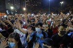 Pro-democracy football fans gather to form a human chain as they sing songs at Victoria Park in Hong Kong, Wednesday, Sept. 18, 2019. An annual fireworks display in Hong Kong marking China's National Day on Oct. 1 was called off Wednesday as pro-democracy protests show no sign of ending. (AP Photo/Kin Cheung)
