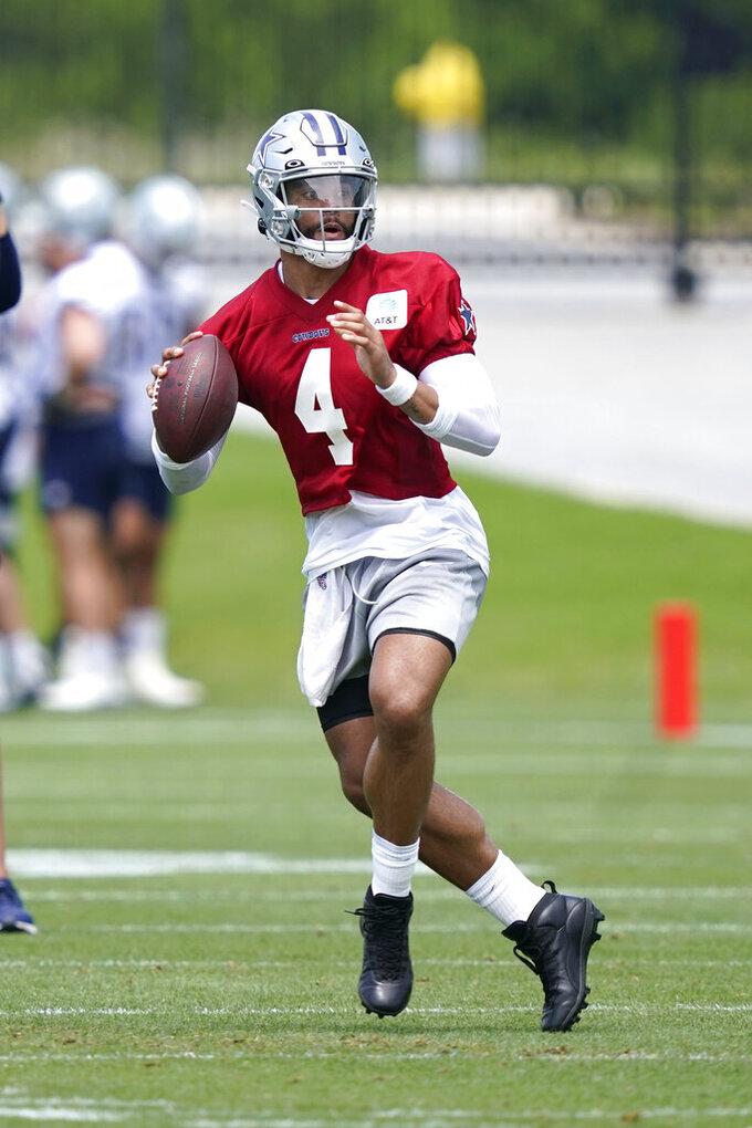 Dallas Cowboys quarterback Dak Prescott looks to pass during an NFL football team practice Tuesday, June 8, 2021, in Frisco, Texas. (AP Photo/LM Otero)