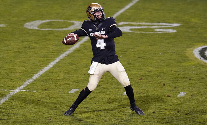 Colorado quarterback Sam Noyer throws a pass against UCLA in the second half of an NCAA college football game Saturday, Nov. 7, 2020, in Boulder, Colo. (AP Photo/David Zalubowski)