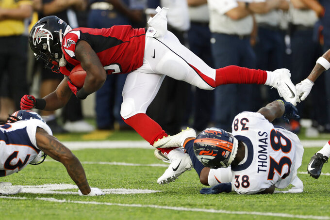 Denver Broncos' Shamarko Thomas (38) tackles Atlanta Falcons' Marcus Green (3) on a punt return during the first half of the Pro Football Hall of Fame NFL preseason game Thursday, Aug. 1, 2019, in Canton, Ohio. (AP Photo/Ron Schwane)