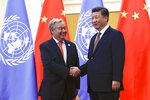 FILE - In this Sept. 2, 2018 file photo, United Nations Secretary-General Antonio Guterres, left, shakes hands with Chinese President Xi Jinping before their bilateral meeting at the Great Hall of the People in Beijing.  The descriptions that China's state media rolled out ahead of leader Xi's speech Tuesday, Sept. 22, 2020, at the annual gathering of world leaders at the United Nations lauded him as as a