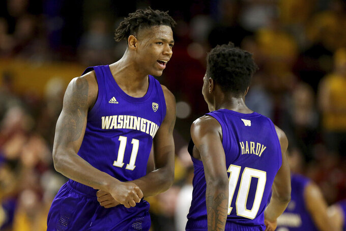Washington's Nahziah Carter (11) celebrates with teammate Elijah Hardy (10) after hitting a 3-pointer against Arizona State late in the second half of an NCAA college basketball game Thursday, March 5, 2020, in Tempe, Ariz. Washington won 90-83. (AP Photo/Darryl Webb)