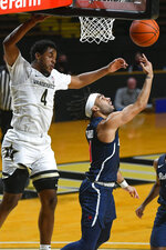 Richmond guard Jacob Gilyard shoots a reverse layup as Vanderbilt guard Jordan Wright (4) defends during the second half of an NCAA college basketball game Wednesday, Dec. 16, 2020, in Nashville. Richmond won 78-67. (AP Photo/John Amis)