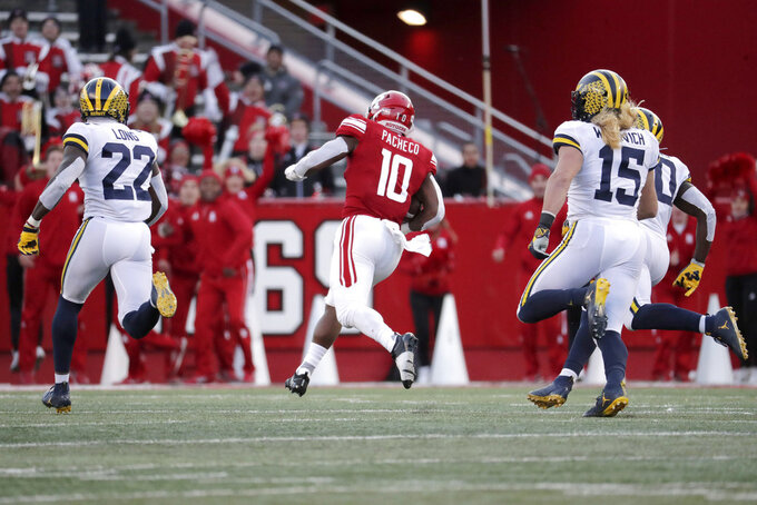 Rutgers running back Isaih Pacheco (10) breaks free for a long touchdown run as Michigan's David Long (22) and Chase Winovich (15) chase after him during the first half of an NCAA college football game, Saturday, Nov. 10, 2018, in Piscataway, N.J. (AP Photo/Julio Cortez)