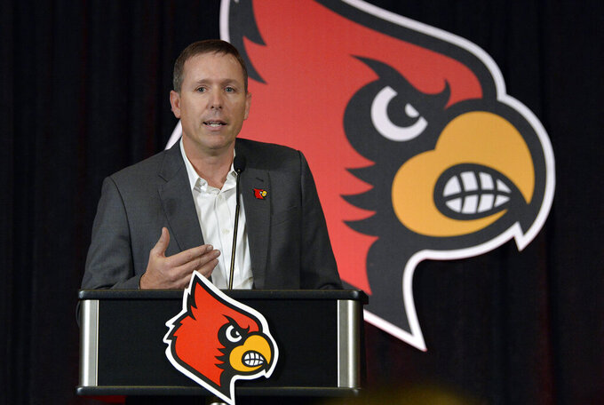 FILE - In this Dec. 4, 2018, file photo, Scott Satterfield speaks to the media and gathered fans following the announcement of his hiring as Louisville's new head NCAA college football coach in Louisville, Ky. The first-year Louisville coach changed the Cardinals' football schedule to finish workouts before spring break. Satterfield has said he wants more time to evaluate the players he has and identify needs with rebuilding Louisville coming off a 2-10 season.  (AP Photo/Timothy D. Easley, File)