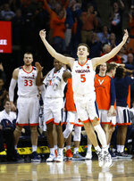 Virginia guard Kyle Guy (5) celebrates a 3-pointer during the first half of an NCAA college basketball game against Florida State in Charlottesville, Va., Saturday, Jan. 5, 2019. (AP Photo/Steve Helber)