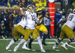 Notre Dame quarterback Ian Book (12) throws a pass in the first quarter of an NCAA college football game against Michigan in Ann Arbor, Mich., Saturday, Oct. 26, 2019. (AP Photo/Tony Ding)
