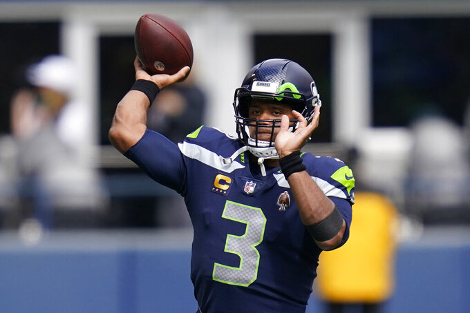 Seattle Seahawks quarterback Russell Wilson passes during warmups before an NFL football game against the Tennessee Titans, Sunday, Sept. 19, 2021, in Seattle. (AP Photo/Elaine Thompson)