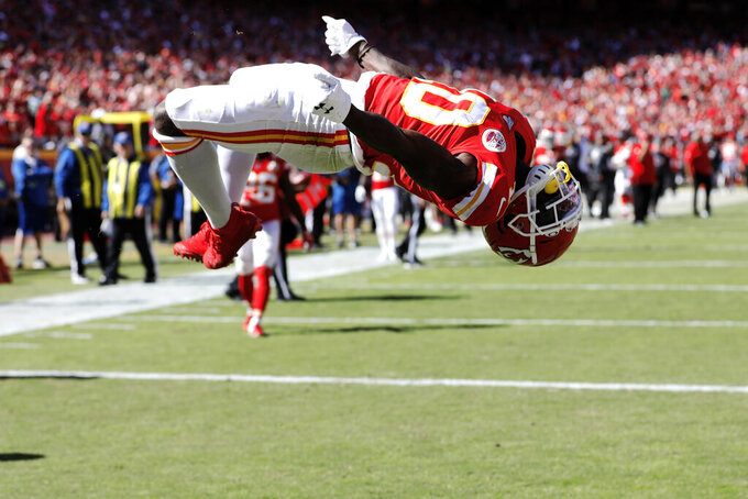 Kansas City Chiefs wide receiver Tyreek Hill (10) does a flip as he celebrates a touchdown during the second half of an NFL football game against the Houston Texans in Kansas City, Mo., Sunday, Oct. 13, 2019. (AP Photo/Colin E. Braley)