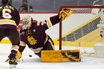 Minnesota Duluth goaltender Zach Stejskal (35) stretches to clear the puck against Massachusetts during the second period of an NCAA men's Frozen Four hockey semifinal in Pittsburgh, Thursday, April 8, 2021. (AP Photo/Keith Srakocic)