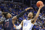 Kentucky's EJ Montgomery (23) shoots while defended by Fairleigh Dickinson's Elyjah Williams (21) during the first half of an NCAA college basketball game in Lexington, Ky., Saturday, Dec. 7, 2019. (AP Photo/James Crisp)