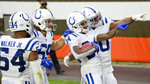 Indianapolis Colts cornerback Isaiah Rodgers (34) celebrates with teammates after Rodgers returned a kickoff for 101-yard touchdown during the second half of an NFL football game against the Cleveland Browns, Sunday, Oct. 11, 2020, in Cleveland. (AP Photo/David Richard)
