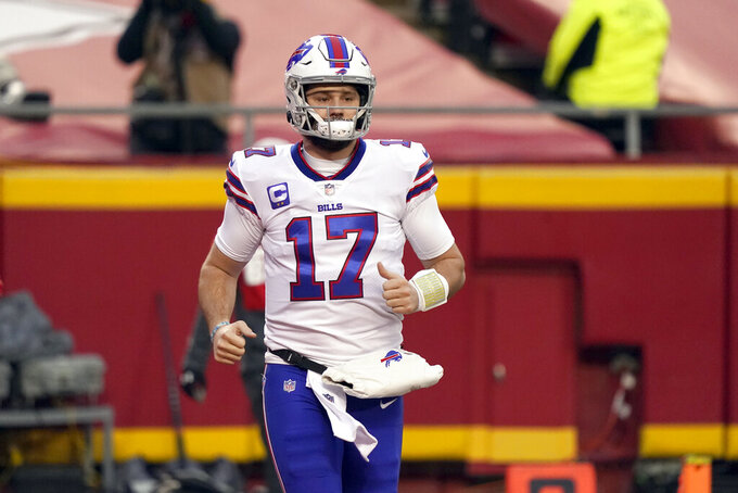 Buffalo Bills quarterback Josh Allen runs onto the field before the AFC championship NFL football game against the Kansas City Chiefs, Sunday, Jan. 24, 2021, in Kansas City, Mo. (AP Photo/Jeff Roberson)