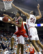 North Carolina State guard Markell Johnson, front left, shoots while defended by Auburn center Austin Wiley (50) during the first half of an NCAA college basketball game Thursday, Dec. 19, 2019, in Auburn, Ala. (AP Photo/Julie Bennett)