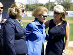 FILE - In this Feb. 26, 2011, file photo, Joan Steinbrenner, widow of George Steinbrenner, center, walks with daughters Jessica Steinbrenner, left, and Jennifer Steinbrenner Swindal, right, following a tribute for their late husband and father before a baseball spring training game against the Philadelphia Phillies, at Steinbrenner Field in Tampa, Fla. Joan Steinbrenner passed away Friday, Dec. 14, 2018, at her home in Tampa, Fla. She was 83. (AP Photo/Charlie Neibergall, File)