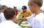 Cleveland Browns quarterback Baker Mayfield first bumps kids during the Baker Mayfield ProCamp, Wednesday, July 21, 2021, in Gates Mills, Ohio. (Joshua Gunter/Cleveland.com via AP)