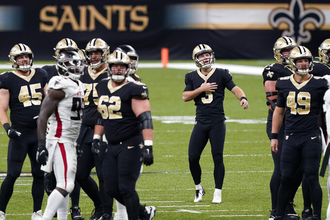 New Orleans Saints kicker Wil Lutz (3) reacts after missing a field goal in the first half of an NFL football game against the Atlanta Falcons in New Orleans, Sunday, Nov. 22, 2020. (AP Photo/Butch Dill)