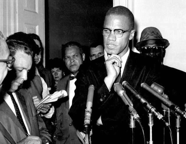 FILE - In this May 16, 1963, file photo, civil rights leader Malcolm X speaks to reporters in Washington, D.C.